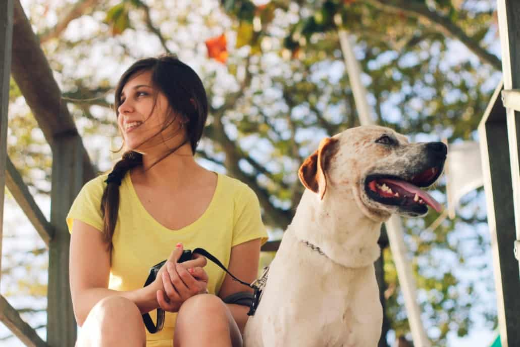 woman walking dog on leash, dog walk schedule